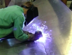 Student Welds Hull of Boat