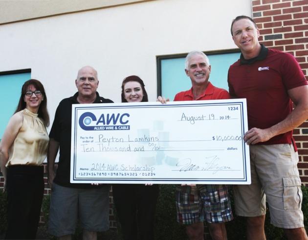 AWC owners awarding scholarship to Peyton Lamkins